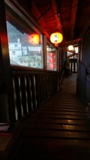 Wooden, slightly uneven walkway leading to 2nd floor