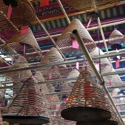 Spiral incense hanging from the ceiling of a popular ancient temple.