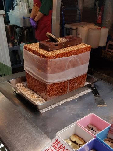 The main ingredient: A block of candied peanut. The hand plane on top is used to shave the block of candied peanut into fine shavings.