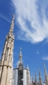 Wispy clouds against clear blue sky on Duomo di Milano.