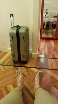 Luggage and feet of a tired man.