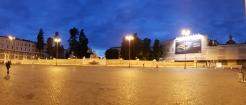 Empty public square at night.