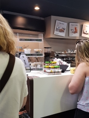 Drink coffee over a counter.