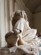 The statue's sole looks like it has been walking.