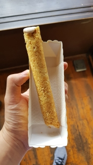 Freshly made egg roll filled with chilled cream.