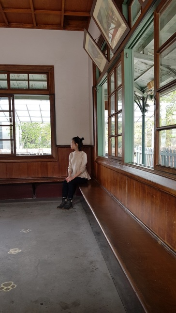 Beautiful long wooden bench in a railway station.