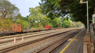 Right side of the railway track.