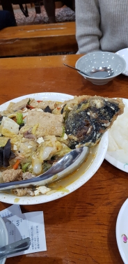 A steaming bowl of Chiayi's famous stewed fish head.