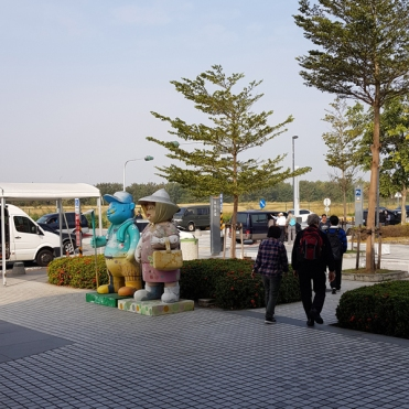 Mascots welcoming visitors to Chiayi, outside the HSR Station