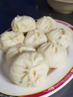 Steaming, hot buns with pork filling.