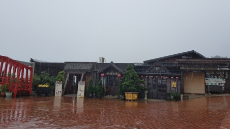 Japanese style buildings in the rain.