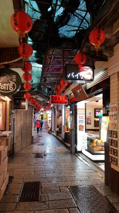 Wet floor, narrow street of Jiufun, Taiwan.