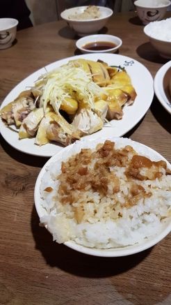 Steamed chicken with ginger strips, and a bowl of braised pork rice.