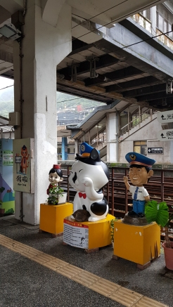 Mascots welcoming visitors at the station.