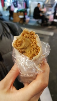 Candied peanut shavings with ice cream and fresh cilantro wrapped in a crepe? Yes please.
