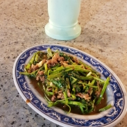 Slices of mutton and morning glory stir-fried with Sha Char.