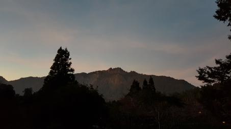 Majestic mountain lit by sun set.