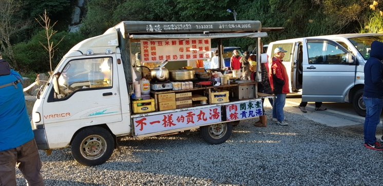 Vendor selling hot food. Must be pretty good business.
