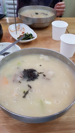 Traditional Korean noodles in potato soup.