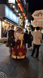 Tourists in traditional Korean outfit walking the street of Insadong. Seoul, Korea.