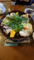 A vegetable hotpot filled with mushrooms, tofu, squash and other healthy plants. Insadong, Seoul, Korea.