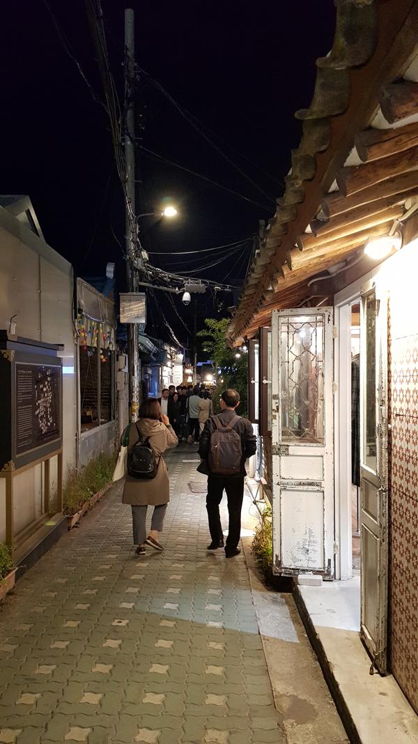 Couple exploring Ikseon-dong Hanok Village. Seoul, Korea.