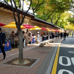 A flea market with light crowds, outside Seoul Museum of Art. Korea.