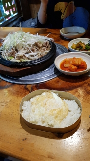 Korean meal of preserved vegetables, bulgogi pork, rice and egg. Seoul, Korea.
