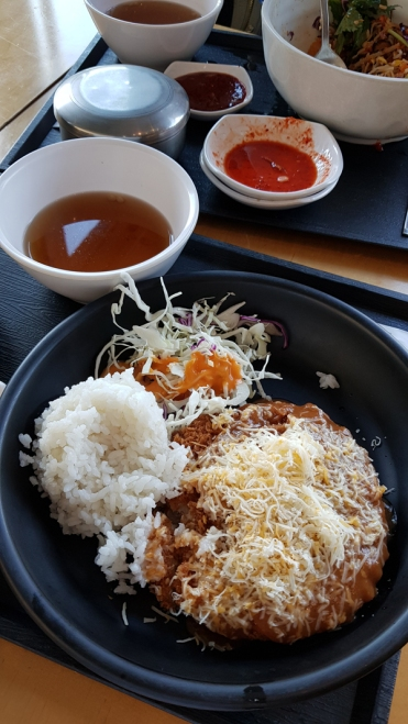 A juicy, fried pork cutlet with melted cheese, served with rice at National Museum of Korea.