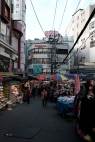 Selling wares wherever there is space. Namdaemun market. Seoul, Korea.