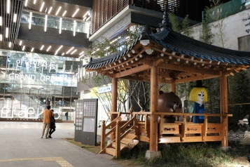 Sculptures of popular mascots from popular mobile app, Line, standing in a traditional Korean hut.