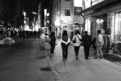 Five ladies, walking down the street. Black and white street photography of Isadong, Seoul, Korea.