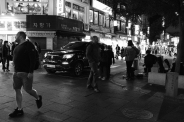 Foreign visitors. Black and white street photography of Isadong, Seoul, Korea.