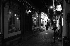Late night shopper at Ikseon-dong Hanok Village. Seoul, Korea.