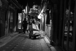 Elderly woman pushing trolley in Ikseon-dong Hanok Village. Seoul, Korea.
