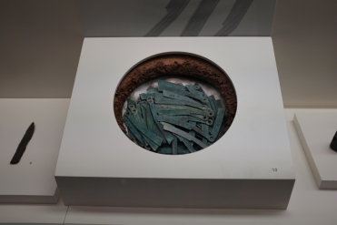 Oxidised ancient, knife-shaped metal currency displayed in National Museum of Korea.