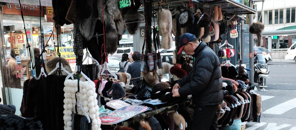 A Vendor selling fur coats at Namdaemun market. Seoul, Korea.