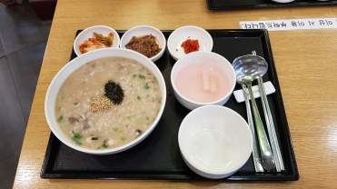 Korean octopus porridge with side dishes in Seoul, Korea.