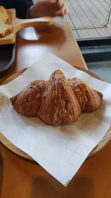 A large fluffy and buttery croissant in Seoul, Korea.