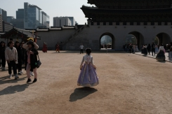 A young girl in hanbok, at Gwanghwamun Gate. Seoul, Korea.