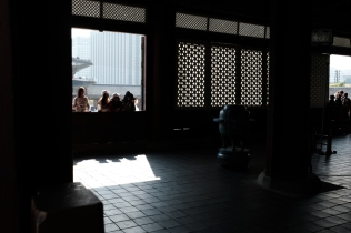 Visitors admiring the throne room from the front at Gyeongbokgung Palace. Seoul, Korea.