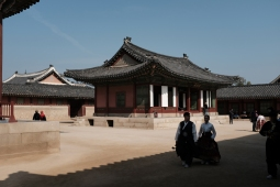 Young couple in traditional Korean attire walking in Gyeongbokgung Palace. Seoul, Korea.