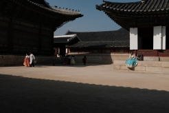 Giggle young lady in hanbok in Gyeongbokgung Palace. Seoul, Korea.