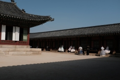 A lot of visitors taking pictures in Gyeongbokgung Palace. Seoul, Korea.