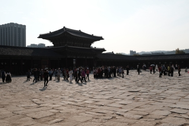 Hordes of visitors at the entrance of Gyeongbokgung Palace. Seoul, Korea.
