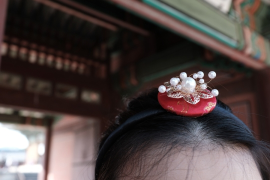 Red hair ornament in a hanbok. Seoul, Korea.