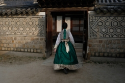 Young lady wearing Korean hanbok in Changdeokgung Palace. Seoul, Korea.
